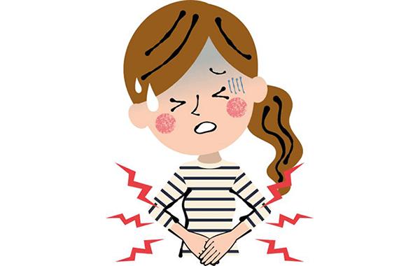 生理痛でお腹が痛い女性